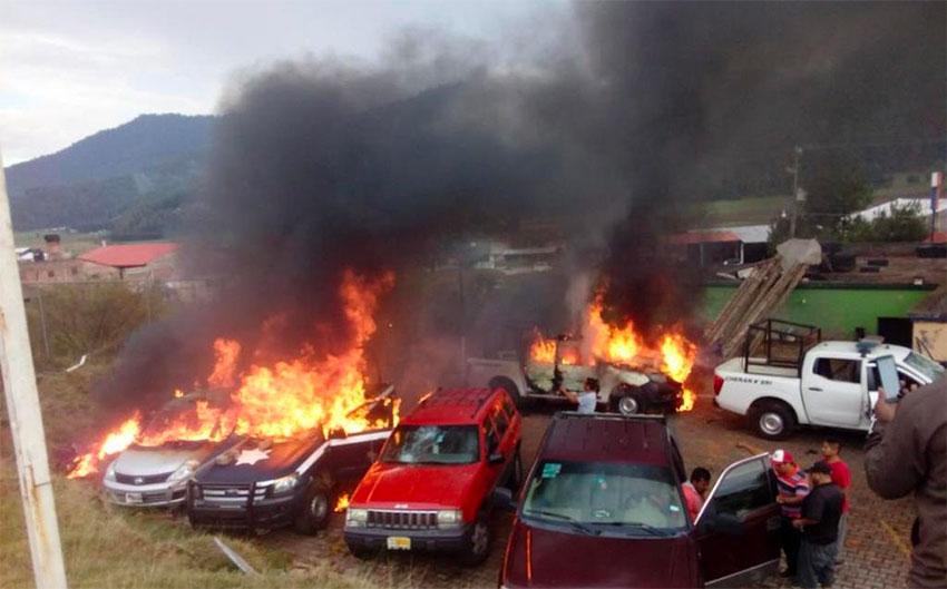 Vehicles burn in Cherán, Michoacán.