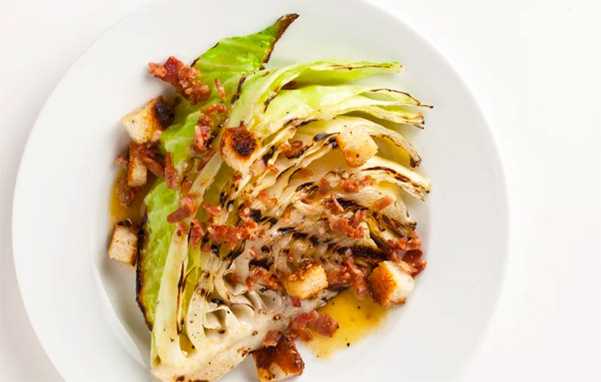 Grilled cabbage with bacon is simple but delicious.