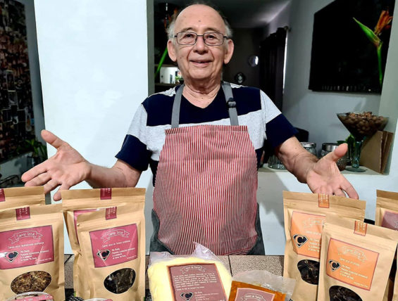 Tito Charly and some of his products.