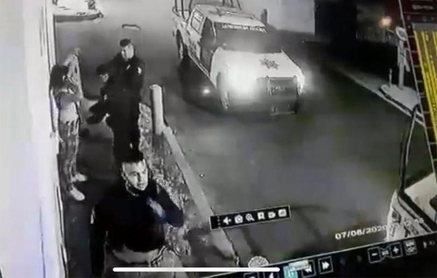 A security camera caught police checking the bag of one of the two women on Sunday night.