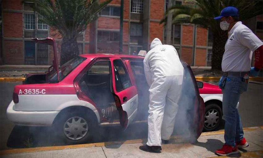 A taxi is disinfected against the coronavirus in Mexico City.