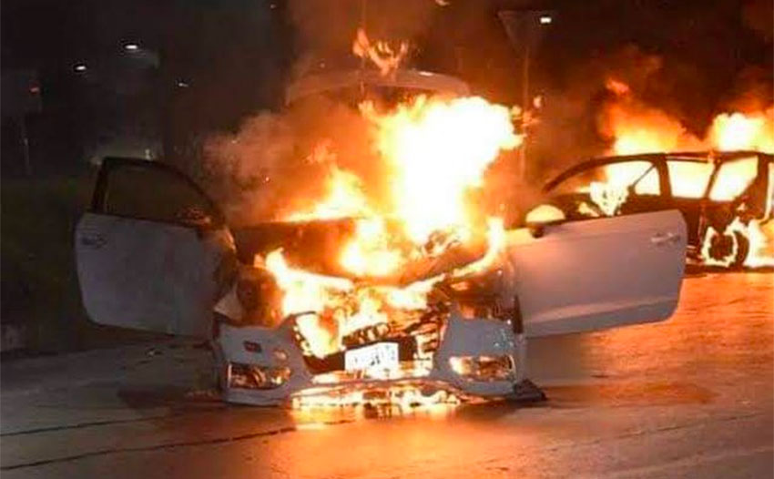 A vehicle burns after a clash between armed gangs in Sonora.