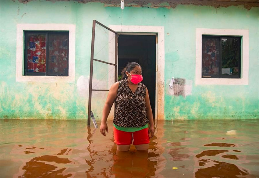 A woman surveys floodwaters in southeastern Mexico on the weekend.