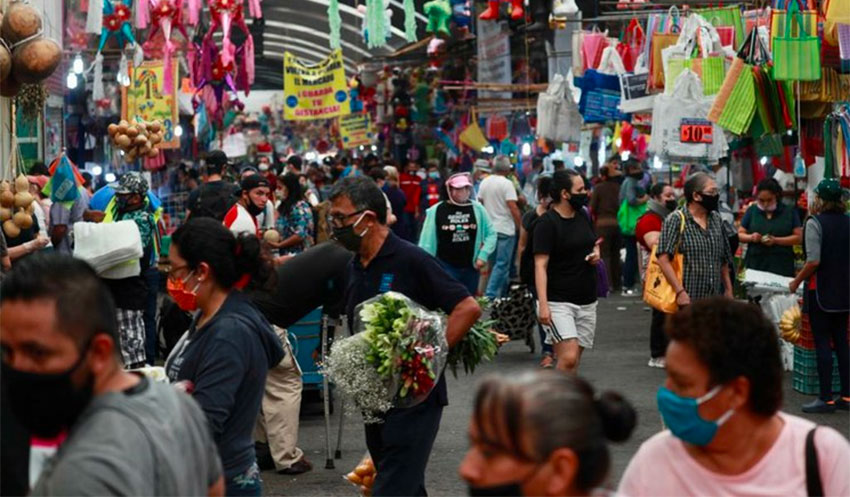 Shoppers on Sunday at the Mercado Jamaica in Mexico City, which has begun easing restrictions as it transitions to an 'orange stoplight' phase.
