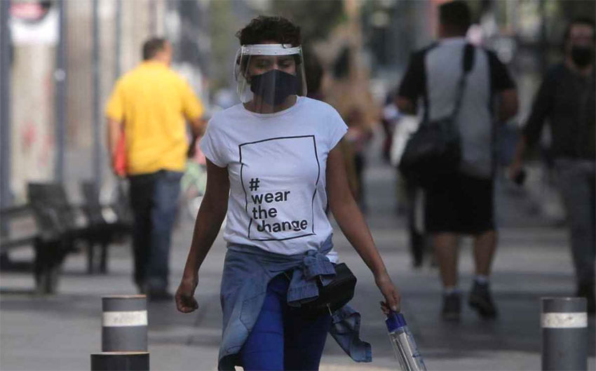 A Mexico City pedestrian in 'the new normal.'