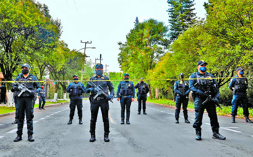 Police guard the crime scene Friday in Mexico City.