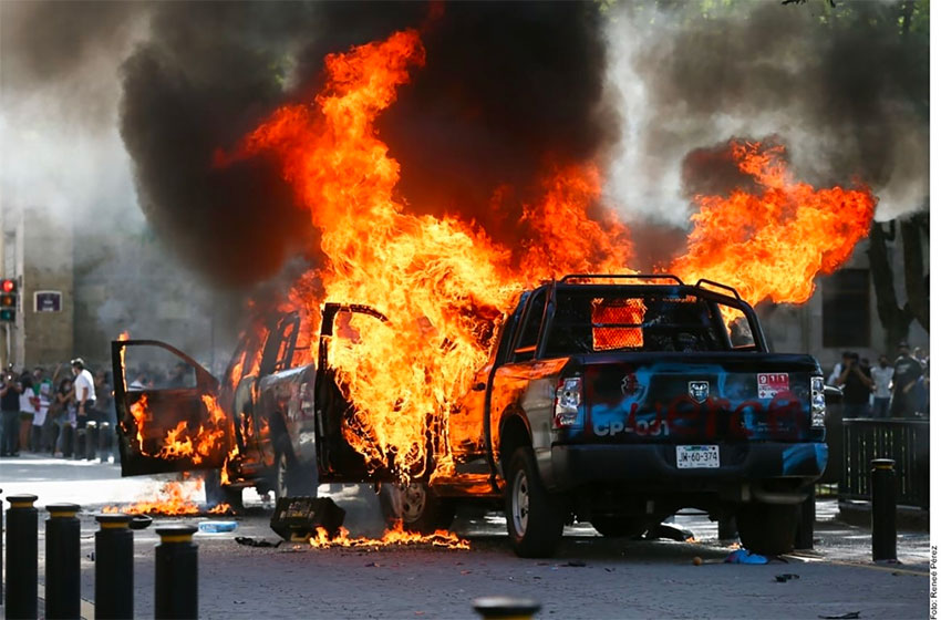 Vehicles burn during Thursday's violent demonstration in the Jalisco capital.