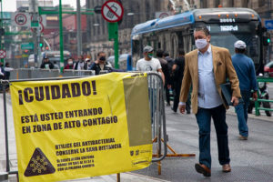 The sign in Mexico City warns that the area is high-risk for the coronavirus.