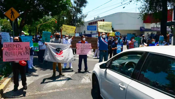 Medical workers in Mexico City protest aggression.