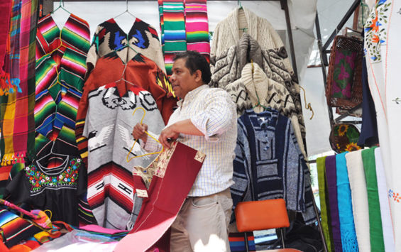 Armando Hernández sells textiles whose designs have been in his family for generations.