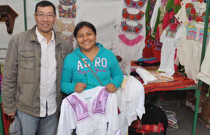 Garments sold by Agustín Girón and his wife Lucia reflect their Tzotzil Mayan roots.