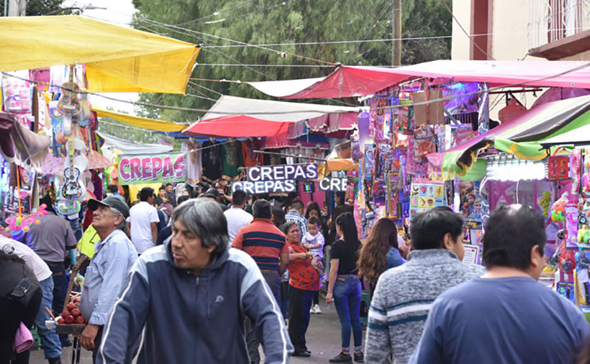 Bustling crowds during the town's fiesta in March.