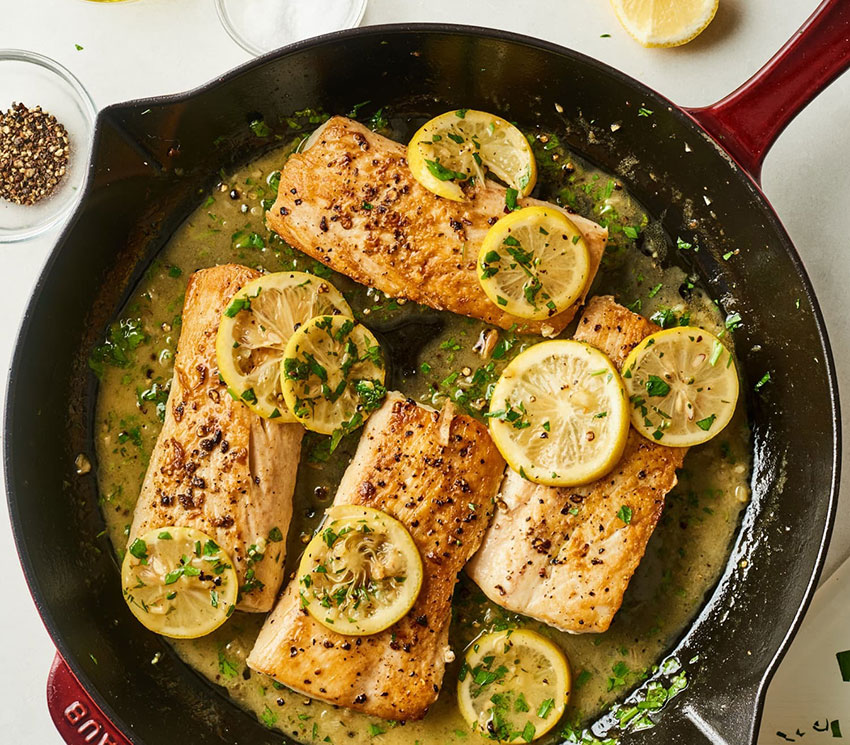 These garlic-lemon dorado fillets are seared in a hot pan.