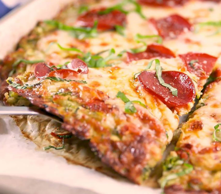 This zucchini pizza crust is tasty enough to eat on its own.