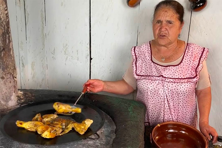 Doña Ángela in her rustic kitchen.