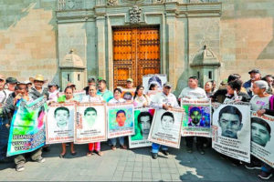 Family members of the missing students outside the National Palace in Mexico City.