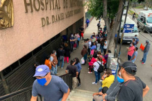 Family members wait outside La Raza National Medical Center in Mexico City for news about relatives inside.