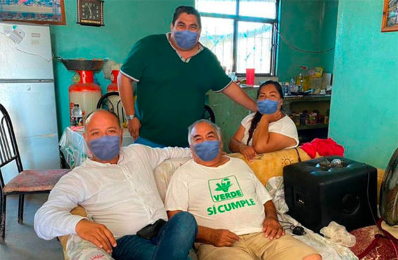 #LordPhotoshop, seated at left, posted digitally altered photos to Facebook, adding masks to people's faces.