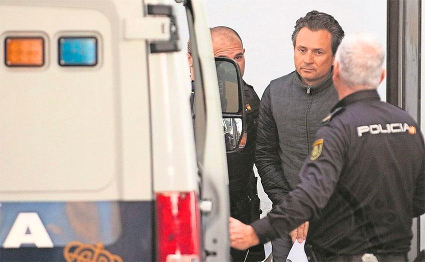 A handcuffed Lozoya in Spain.