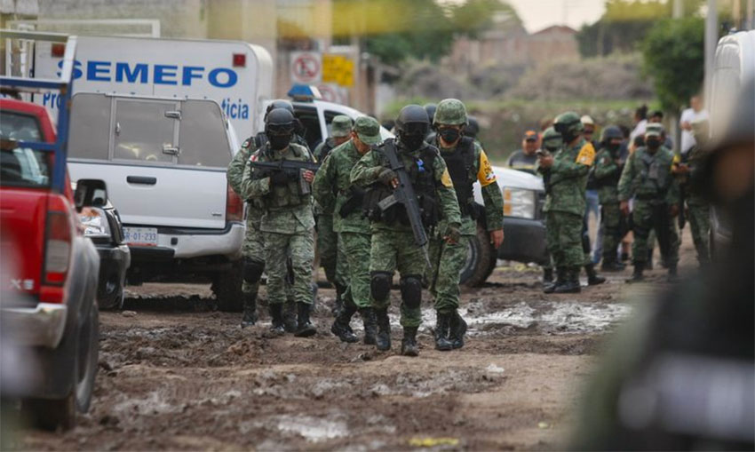 National Guardsmen at the scene of the rehab centre massacre.