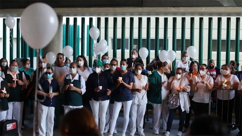 Hospital staff at the ceremony for coronavirus victim.
