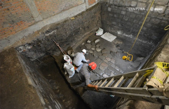 Archaeologists excavate and clean stone floor dating back to the early 16th century