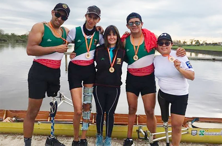 Ramírez, left, and fellow rowing competitors.