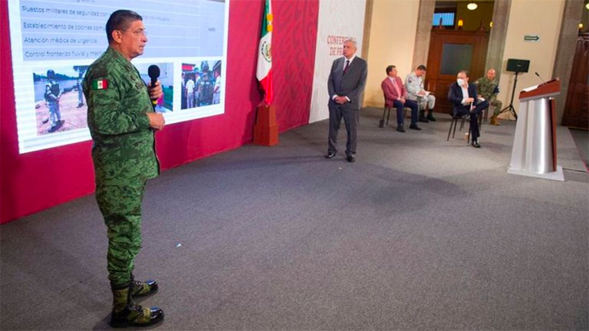 Army chief Sandoval presents a report Monday at the presidential press conference.