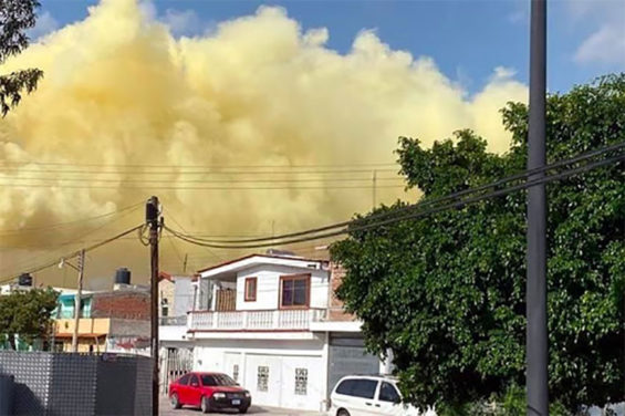 Yellow smoke above homes in Salamanca Thursday.