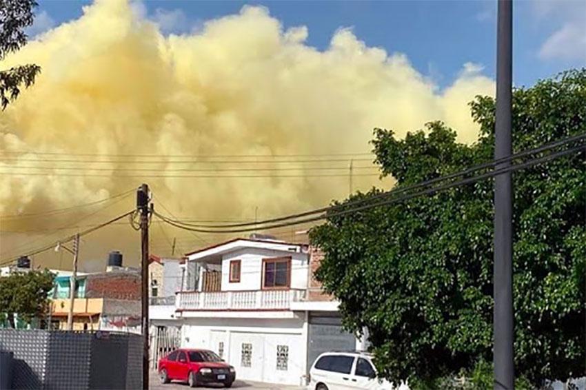 Yellow smoke above homes in Salamanca Thursday.