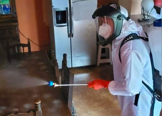 A home in which occupants were diagnosed with Covid-19 is disinfected in Xochimilco, Mexico City.
