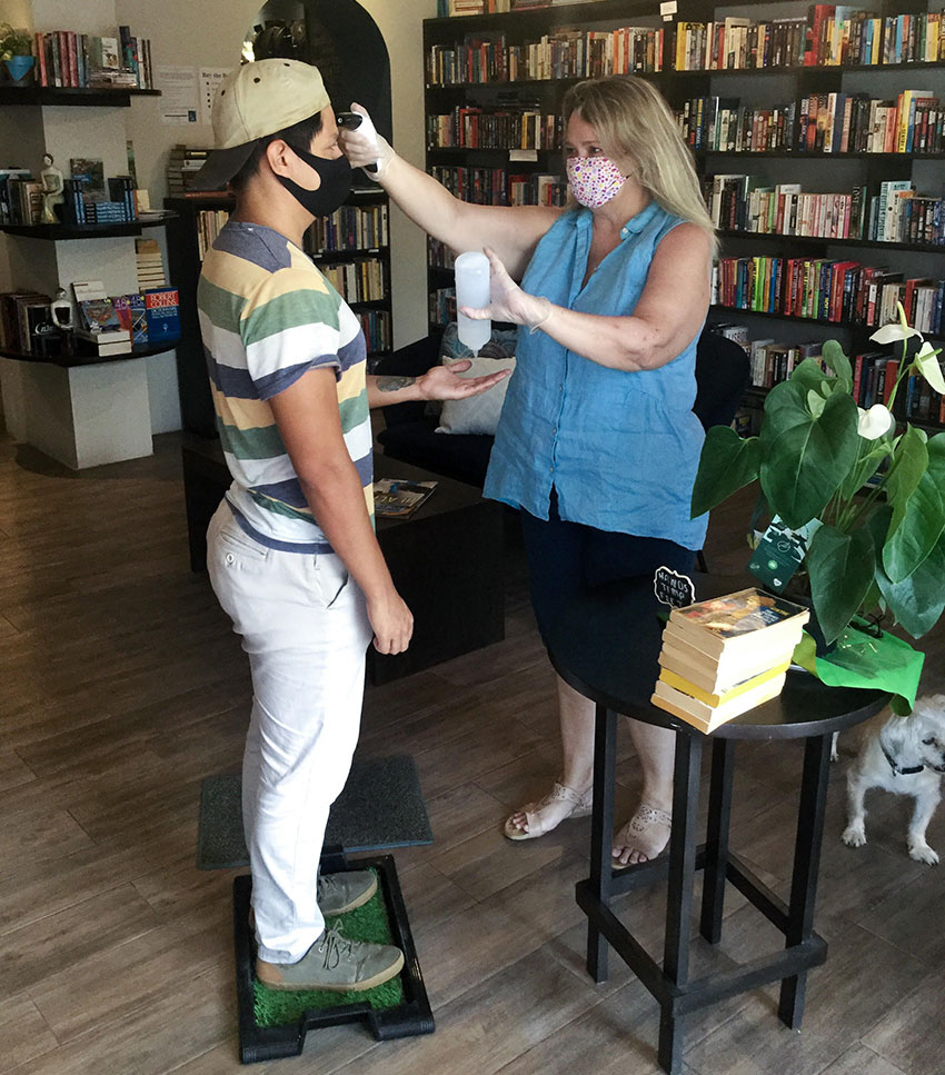 Kelly Casey welcomes a customer to her Puerto Vallarta bookstore and cafe.
