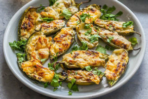 These baked jalapeños are stuffed with hard and cream cheese.