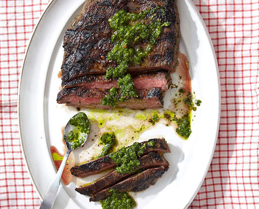 A steak topped with Argentinian chimichurri sauce.