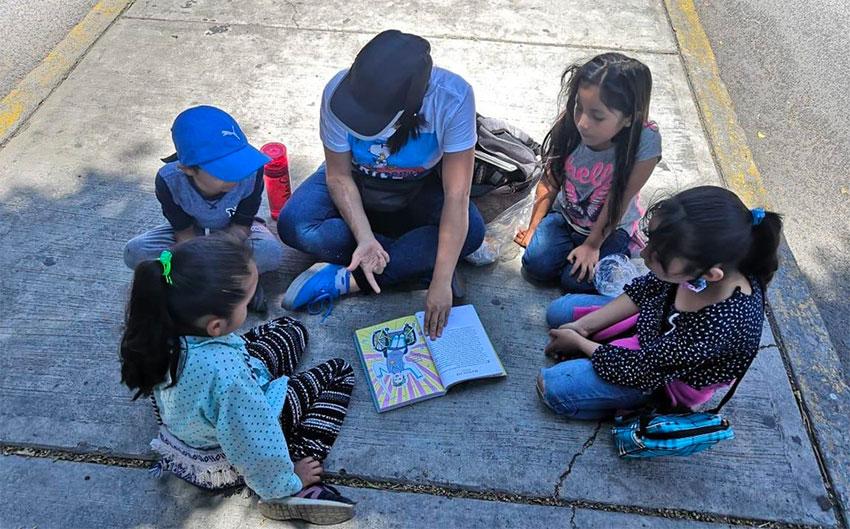 A sidewalk class in session.