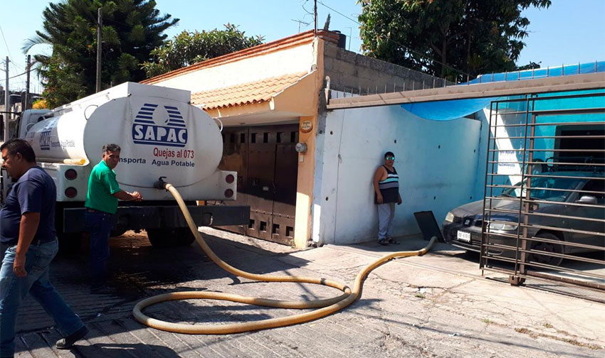 Cuernavaca's water utility makes a delivery to a home in March 2018 after electricity to the pumps was cut off.