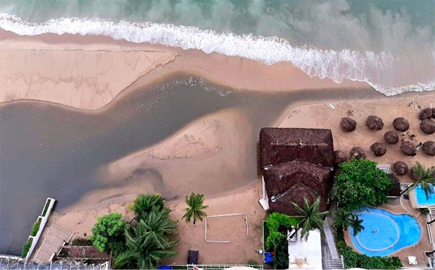 An aerial view of sewage running into the bay.