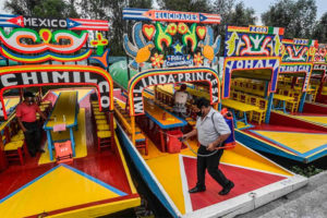 The Xochimilco boats known as trajineras are now operating again with restrictions.