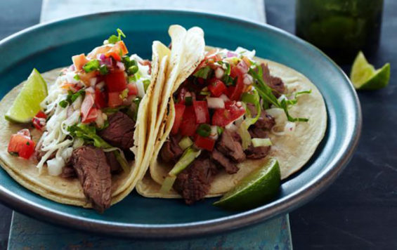 Tacos of carne asada made with an orange marinade.