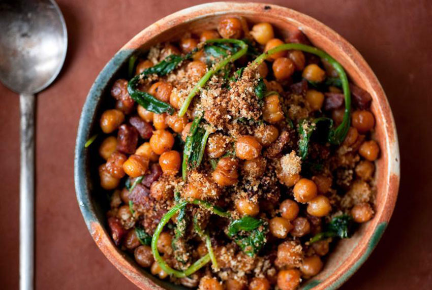 Fried chickpeas with chorizo and spinach.