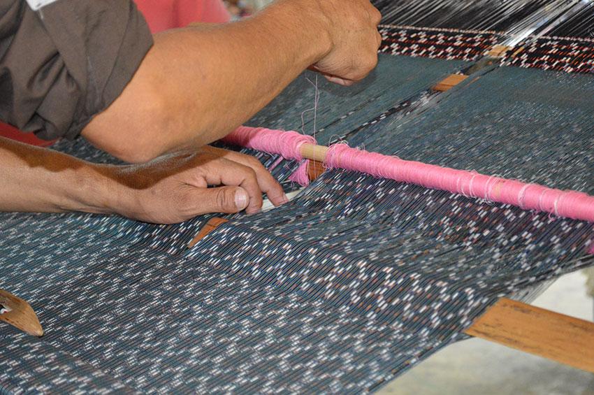 A rebozo is made on a backstrap loom at the Feria de Rebozo in Tenancingo, México state.