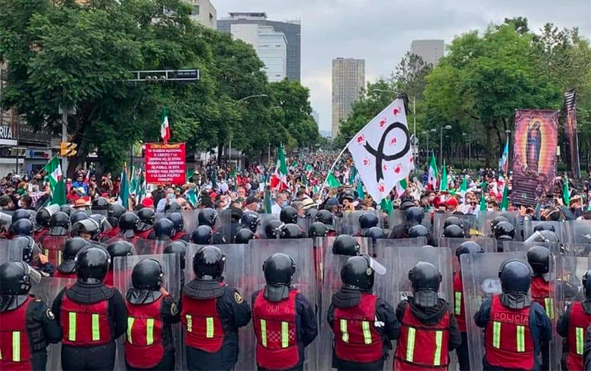 Police prevent the marchers from proceeding to the zócalo on Saturday.