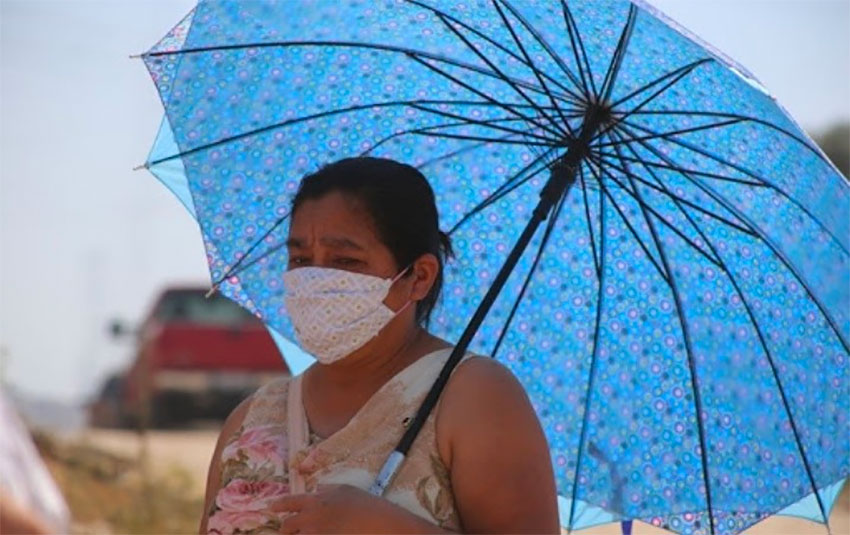 A woman braves the heat in Mexicali