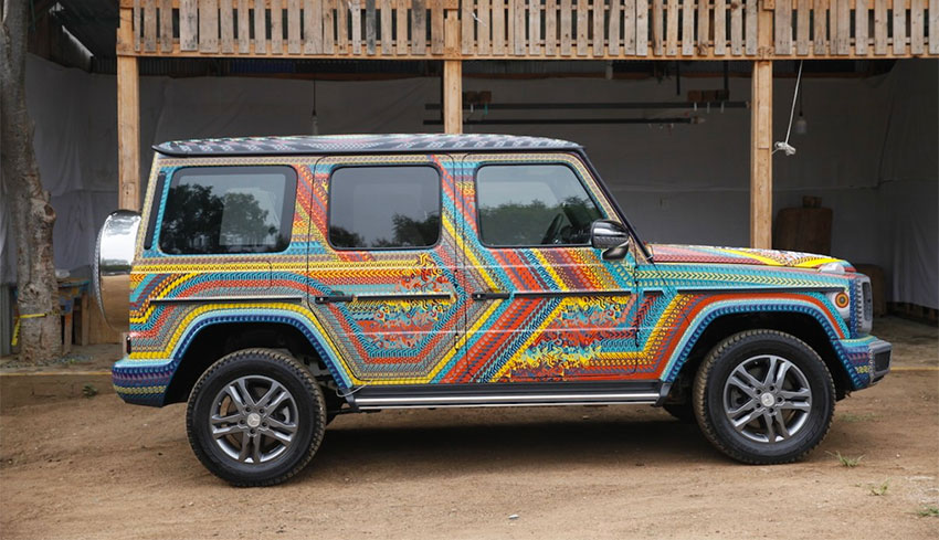 The newly-painted Mercedes SUV.
