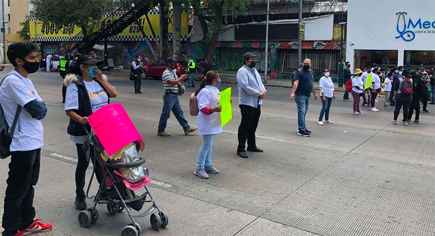 Parents block a street in Mexico City on Thursday.