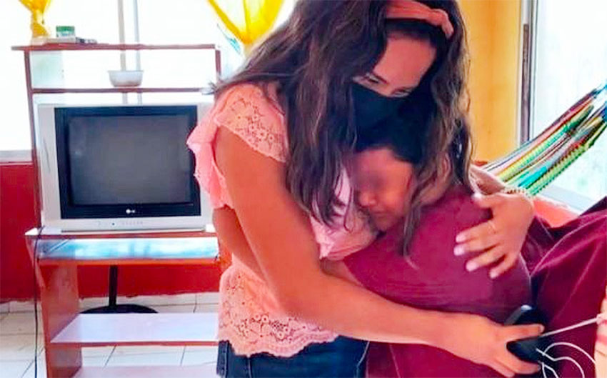 Montiel gets a hug from an emotional Jesús, grateful for having a TV to attend classes.