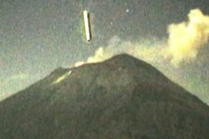 A UFO enters the crater of El Popo, the volcano in central Mexico.