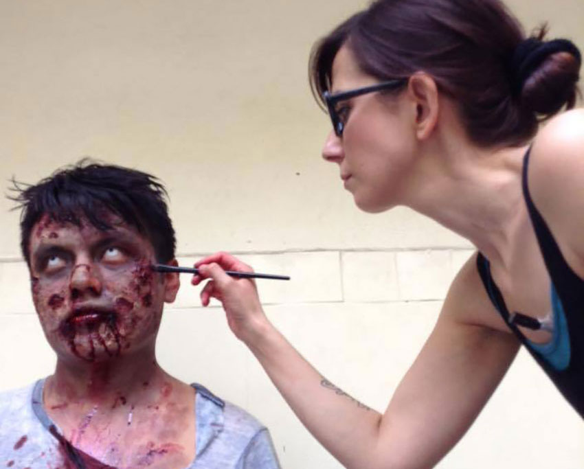 Francesca Dalla works on a zombie figure for a movie prop.