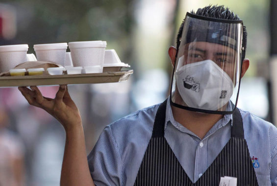 A face mask plus a shield can be a sign that the restaurant is taking Covid precautions seriously.