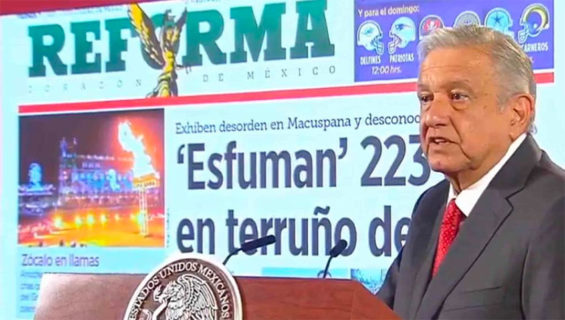 The president exhibits a front page of Reforma over a story with which he took issue, a common occurrence at his daily press conferences.